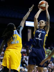 Indiana Fever forward Candice Dupree, right, shoots