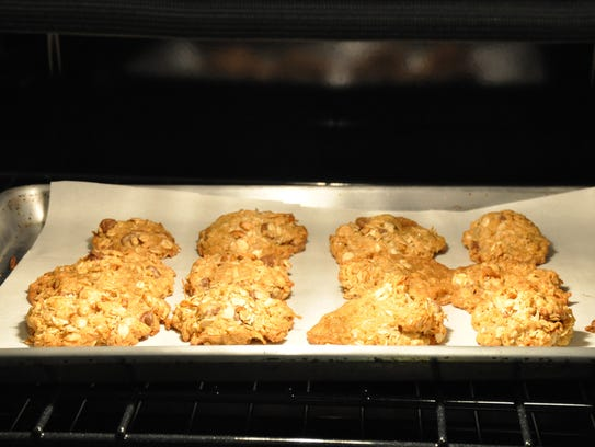 Cowboy Cookies ready to come out of the oven on Sunday,