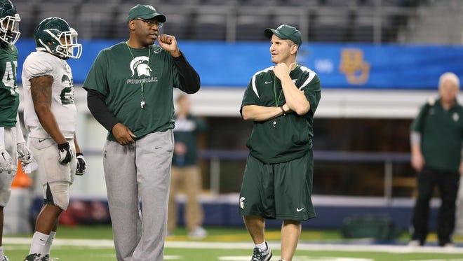Harlon Barnett, left, and Mike Tressel are Michigan State's co-defensive coordinators.