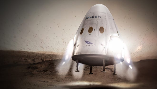 """Concept image of an unmanned SpaceX """"Red Dragon"""" spacecraft landing on Mars."""