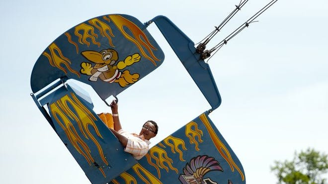 Braxton Jones, 12, rides the Air Crow at Indiana Beach Amusement Resort, in Monticello, on Tuesday, June 4, 2013.
