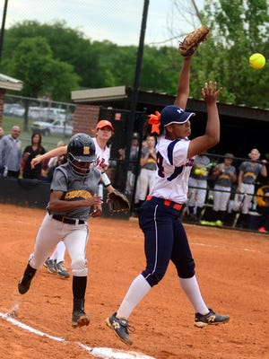 Hendersonville High junior Ace Hanson reaches first base as a throw gets past Beech sophomore Kennedy McCurry during first-inning action. Hanson drove in two runs in the Lady Commandos' 5-4 victory on Tuesday evening.