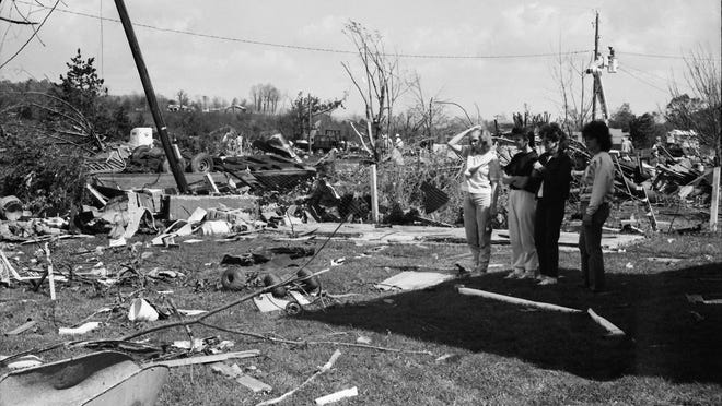 Residents of Augusta Springs survey the damage following a May 4, 1990, tornado that ripped through the village.