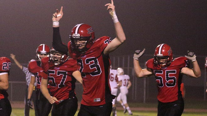 East players celebrate as they tie the score at 7-7 near the end of the third quarter as the Lumberjacks beat Wisconsin Rapids 19-13 at Thom Field in Wausau on Thursday. The players are Dylan Hamlin (73) and Marcus Welsh (55); the player wearing No. 57 was not listed in the East program.