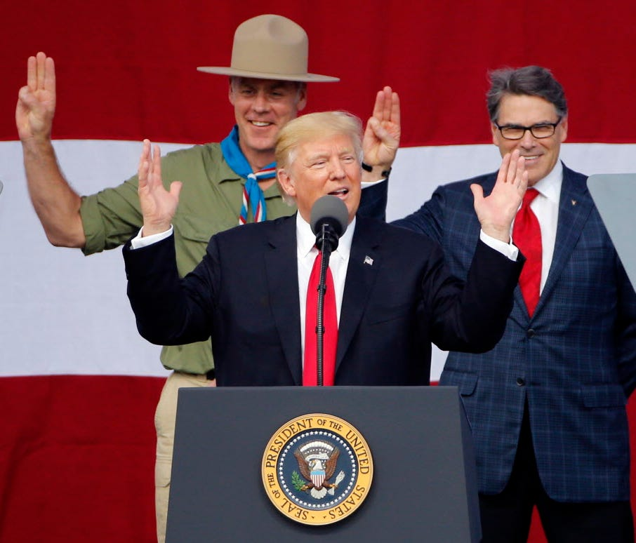 President Trump, front left, gestures as former Boy Scouts Interior Secretary Ryan Zinke, left, and Energy Secretary Rick Perry watch at the 2017 National Boy Scout Jamboree at the Summit in Glen Jean, W.Va., July 24, 2017.
