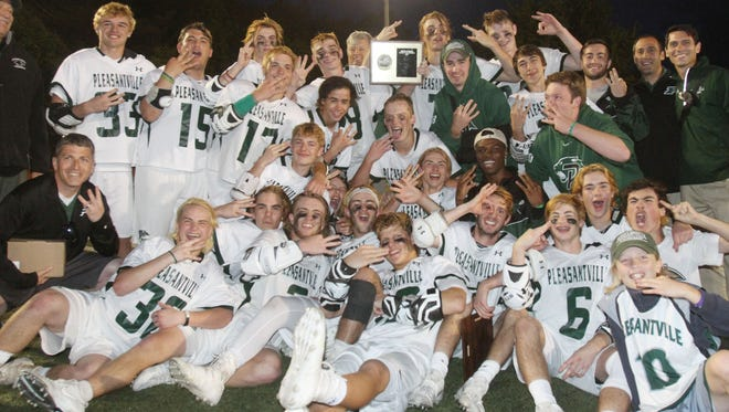 Pleasantville players celebrate with the Section 1 plaque after defeating Briarcliff 11-7 in the boys lacrosse Section 1 Class C championship game at Mahopac High School May 26, 2017.
