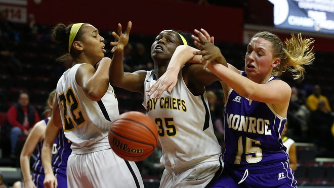 Piscataway's Nadia Wooten #22 and Wande Adeyemo #35 battle Monroe's Erin Seppi #15 for a loose ball during the first half of the girls basketball GMC Tournament Final in Piscataway, N.J. on Thursday, February 26, 2015. Photo by Rich Schultz/ Home News Tribune