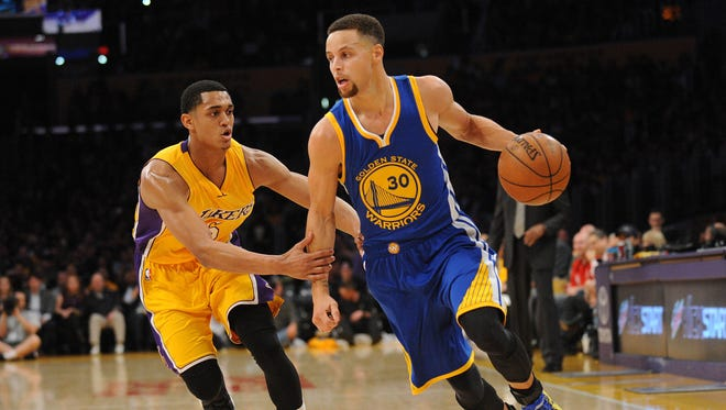 Golden State Warriors guard Stephen Curry (30) moves to the basket against Los Angeles Lakers guard Jordan Clarkson (6) during the first half at Staples Center.