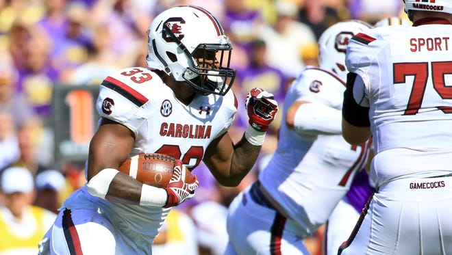 South Carolina Gamecocks running back David Williams (33) runs against the LSU Tigers during the first quarter of a game at Tiger Stadium.  Mandatory Credit: Derick E. Hingle-USA TODAY Sports