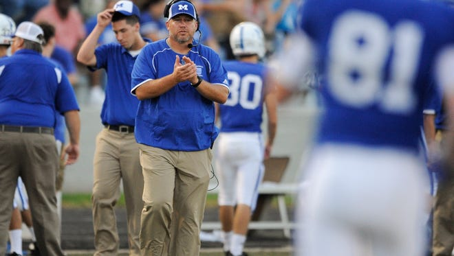 Memorial head coach John Hurley claps during Friday's game against Jasper at Enlow Field at Bosse High School in Evansville.