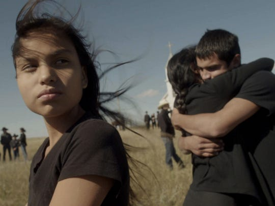 """The film """"Songs My Brothers Taught Me,"""" which was shot entirely on the Pine Ridge Indian Reservation, had its South Dakota premiere on Tuesday. Attending the premiere was Jashaun St. John (left)."""