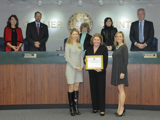 The Board of Collier County Commissioners, Kristi Bartlett, Opportunity Naples Vice President and Andrea Sturzenegger, Vice President, Marketing and Membership, The Greater Naples Chamber of Commerce, presented Judy Green, President/CEO, Premier Sotheby's International Realty, with a commemorative plaque at the Jan. 12 County Commission meeting.