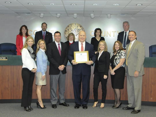 The Board of Collier County Commissioners, Kristi Bartlett and Andrea Sturzenegger presented George Schmelzle, Bill Kuhlman, Donna Engel, Service Department Manager, Sara Hines, and Brandon Hipwell of IRMS with a commemorative plaque at the county commission meeting.