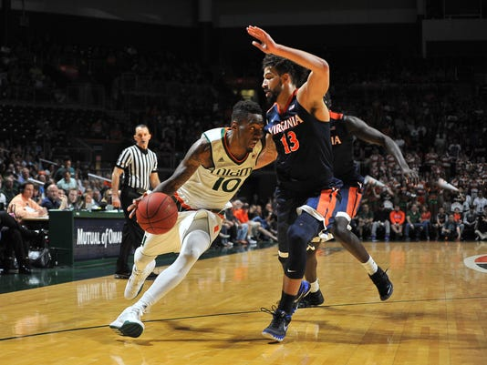 Miami guard Sheldon McClellan drives to the basket as Virginia's Anthony Gill attempts to defend during the first half action of an NCAA college basketball game in Coral Gables, Fla., Monday, Feb. 22, 2016. (AP Photo/Gaston De Cardenas)