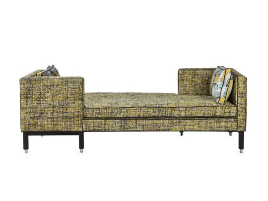 Currey & Co. has introduced a short series of chairs and a contemporary tete a tete sofa.