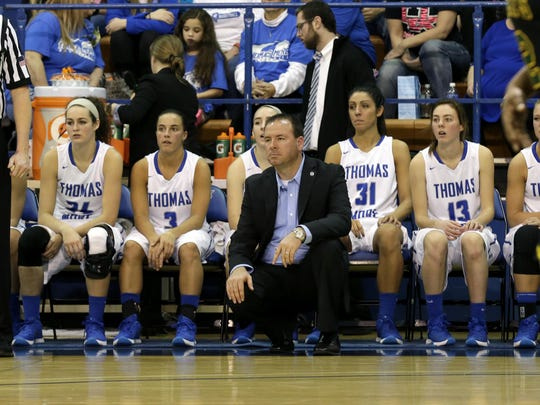 In a game against St. Vincent three years ago, Thomas More coach Jeff Hans watches the on-court action.