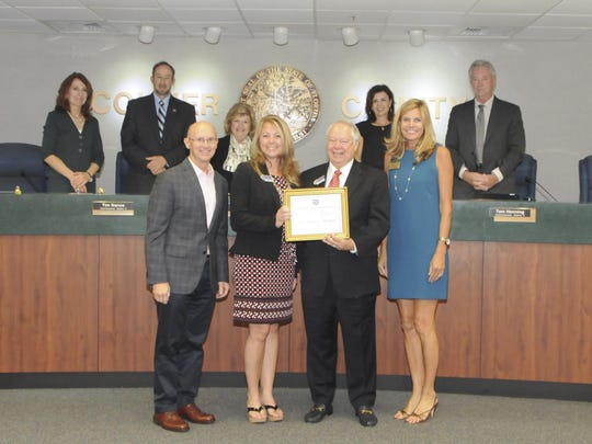 The Board of Collier County Commissioners, Michael Dalby, Greater Naples Chamber of Commerce President and CEO, and Ashley Porraro, Greater Naples Chamber of Commerce Account Executive, presented Gary L. Tice, Chairman and CEO, First Florida Integrity Bank, and Holly Burghardt, Vice President-Branch Manager, First Florida Integrity Bank, with a commemorative plaque at a recent County Commission meeting.