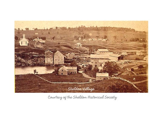This photo of Sheldon Village taken from Main Street east toward Bridge Street clearly shows the mill but also shows all of the other structures built after the bridge in 1837 and before the railroad.