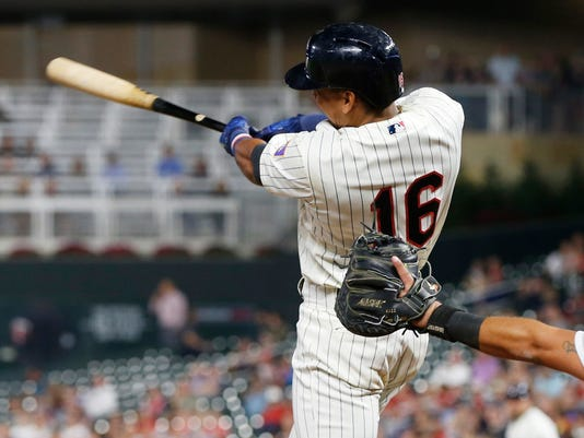 Minnesota Twins' Ehire Adrianza follows through with an RBI single off Chicago White Sox pitcher Chris Beck during the eighth inning of a baseball game Wednesday, Aug. 30, 2017, in Minneapolis. Adrianza drove in four runs with the single and two triples. The Twins won 11-1. (AP Photo/Jim Mone)