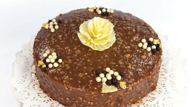 Gianduia cake at Sant Ambroeus is a hazelnut sponge cake with gianduia mousse and layers of hazelnut cream, among other things.