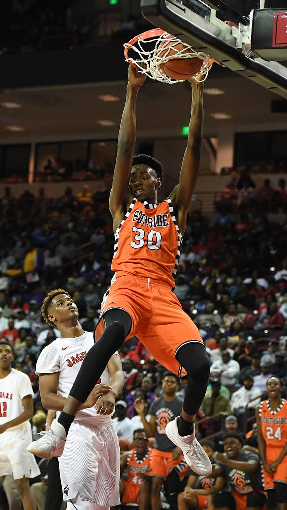 Southside's Jamal Burke (30) dunks against Ridgeland-Hardeeville during the Class AAA boys championship on Saturday, March 3, 2018 at the Colonial Life Arena in Columbia.