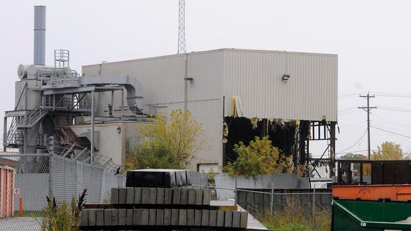 Demilition work is under way on a iron shredder at Midway Iron in St. Cloud.