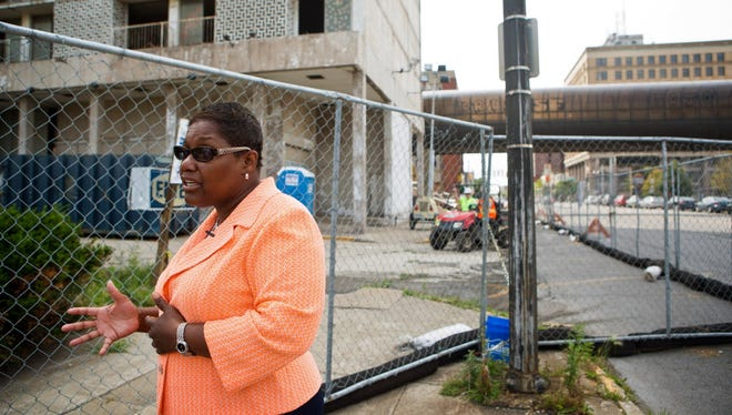 Gary Mayor Karen Freeman-Wilson stands outside of the Sheraton Hotel site, a 14-floor eyesore that was torn down after years of standing vacant.