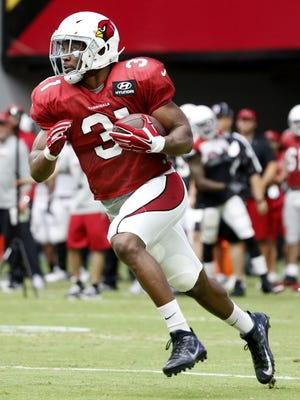 Cardinals' running back David Johnson (31) sprints down the sideline during practice at University of Phoenix Stadium on August 4, 2016, in Glendale.