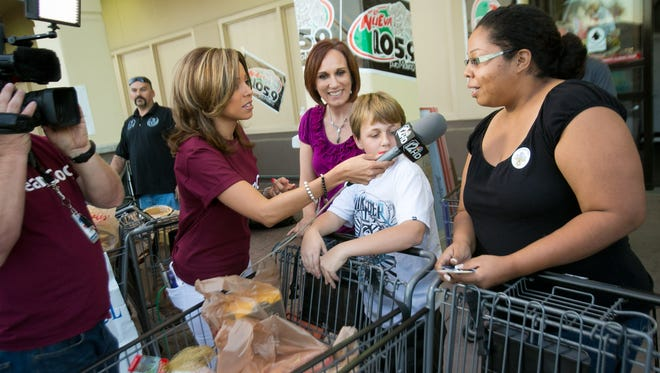 12 News' Caribe Devine interviews shoppers donating food at the Turkey Tuesday food drive at a Bashas' grocery store in Tempe.
