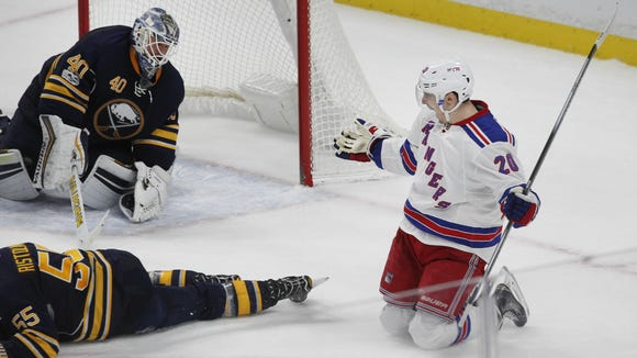 New York Rangers forward Chris Kreider puts the puck past Buffalo Sabres goalie Robin Lehner during the overtime period of Thursday night's game in Buffalo.
