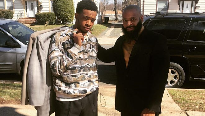 """Author-screenwriter J.M. Benjamin is pictured with his son, Jameel,, in their hometown of Plainfield. Benjamin makes his directorial debut with the 2018 film """"A Time for Finesse,"""" the score for which was written by his son, also known as the rapper Base."""