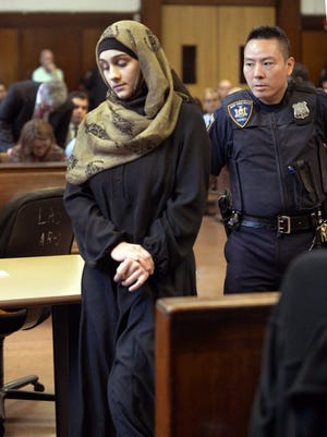 A court officer escorts Ailina Tsarnaeva, sister of Boston Marathon bombing suspect Dzhokhar Tsarnaev, during her appearance in Manhattan Criminal Court on Tuesday, Sept. 30, 2014. Authorities allege Tsarnaeva of North Bergen, N.J., claimed people she knew could bomb the home of a woman who was previously involved with a man who may or may not be her husband.