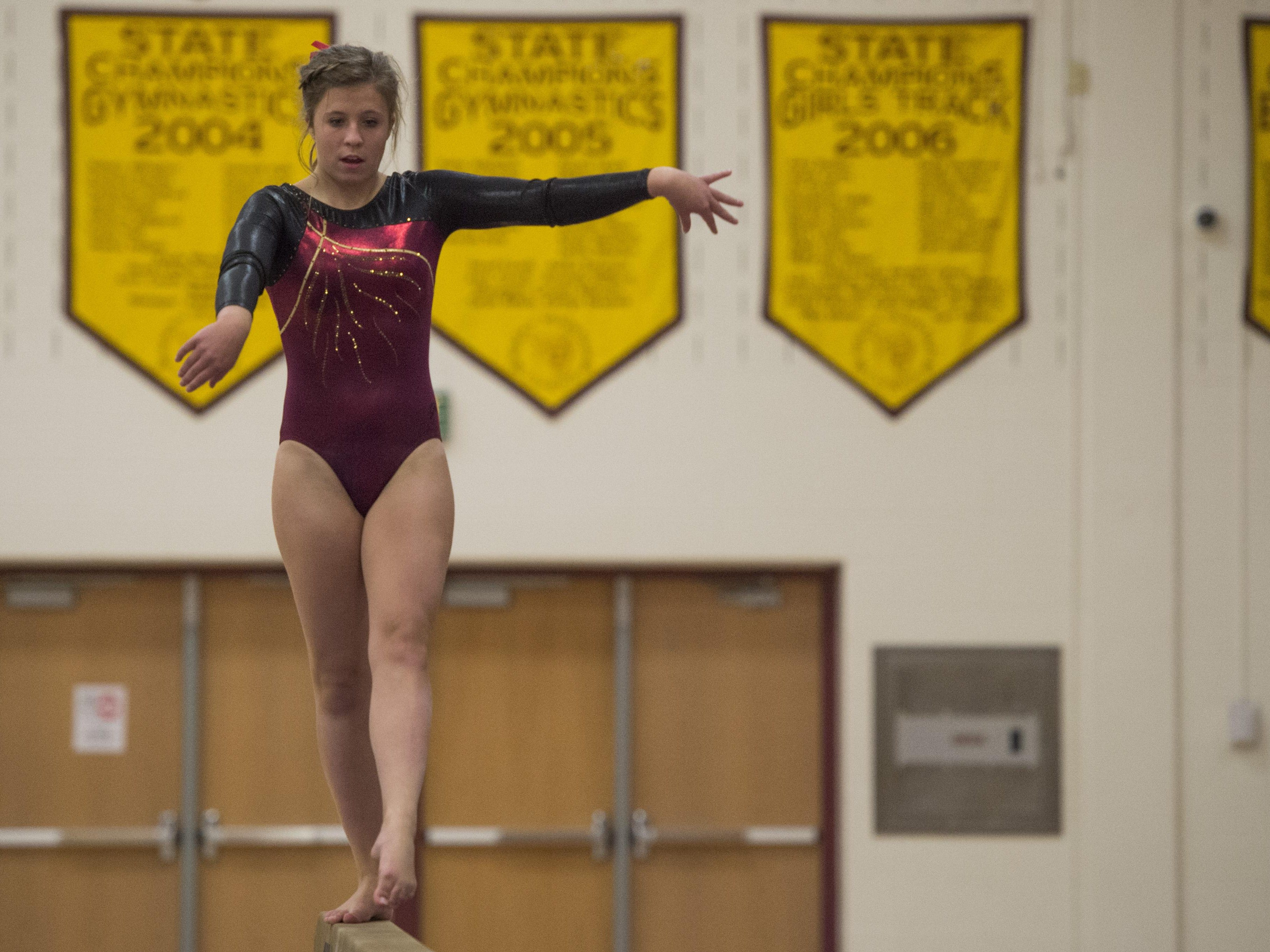 Aidan O'Connell of Rocky Mountain High School performs on the balance beam during a gymnastics competition against Fort Collins at Rocky Mountain High School Wednesday.