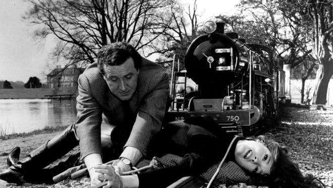 Patrick MacNee comes to the rescue in scene for an episode of ABC-TV's The Avengers, a secret agent series debuting in the U.S. March 28, 1966. Macnee starred in The Avengers from 1961-1969.