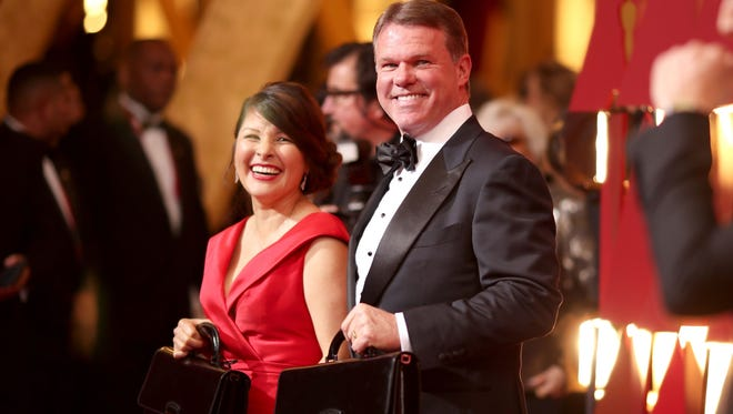 PricewaterhouseCoopers representatives Martha Ruiz and Brian Cullinan attend the 89th Academy Awards on Feb. 26, 2017.