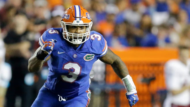Florida linebacker Antonio Morrison rushes against New Mexico State during the second half of an NCAA college football game, Saturday, Sept. 5, 2015, in Gainesville, Fla.