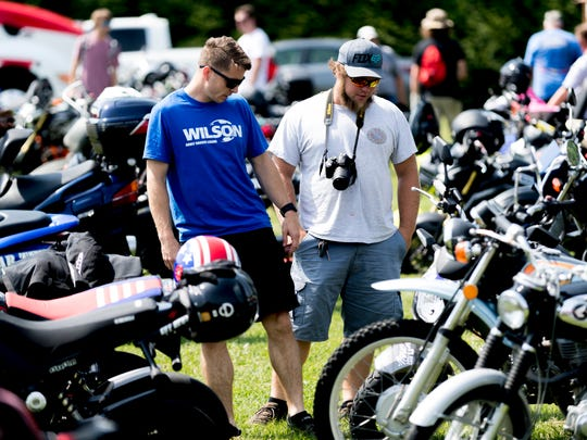 Michael Youngbar, left, and Jordan Bailey, of Wilson, N.C., check out parked bikes at the MNNTHBX Smoky Mountain Crawl in Townsend, Tenn., on Friday, June 8, 2018. Motorcycle enthusiasts from across the country visited the festival, where Honda unveiled two of its newest motorcycles.