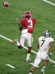 Alabama wide receiver Calvin Ridley (3) catches a touchdown pass while defended by MSU's Demetrious Cox (7) during the third quarter Thursday in the 2015 CFP semifinal at the Cotton Bowl at AT&T Stadium.