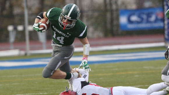 Pleasantville's Declan Mcdermott (14) breaks away from