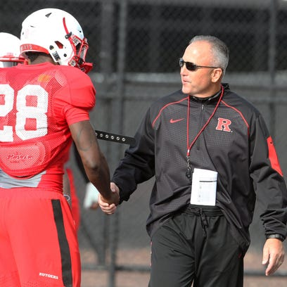 Rutgers coach Kyle Flood chats with freshman safety Najee Clayton at an October practice.
