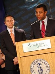 Federal housing monitor James Johnson, right, speaks during a 2010 press conference with Westchester County Executive Rob Astorino in White Plains.