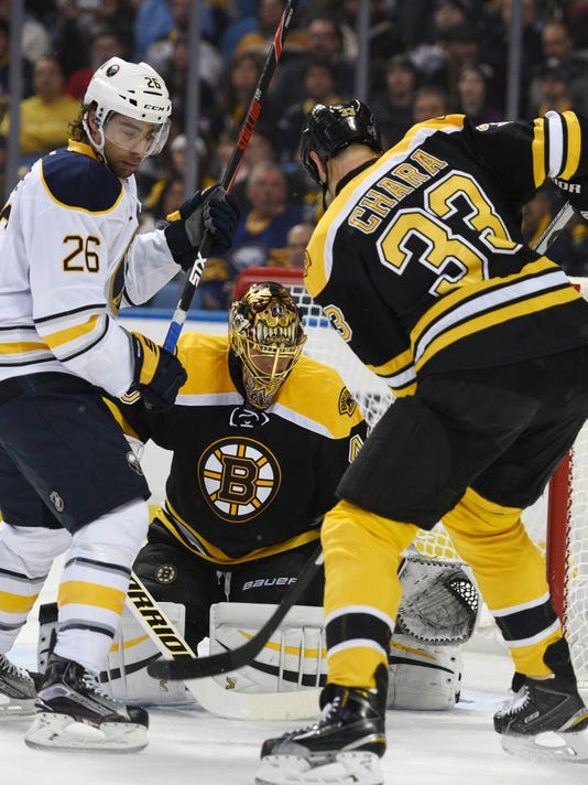 Buffalo Sabres' Matt Moulson (26) battles for a rebound as Boston Bruins' Tuukka Rask, center, and Zdeno Chara (33) defend during the first period of an NHL hockey game, Thursday, Feb. 4, 2016 in Buffalo, N.Y. (AP Photo/Gary Wiepert)
