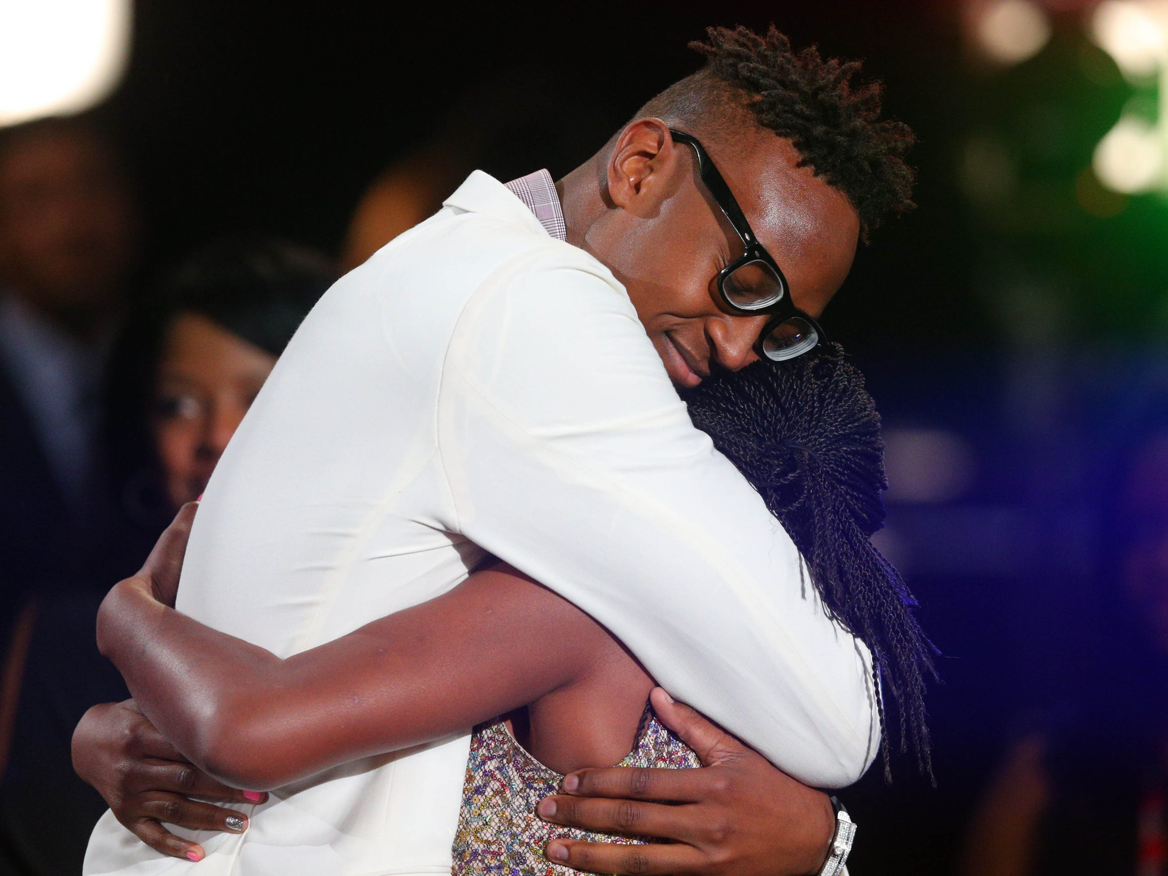 Myles Turner (Texas) receives a hug from family and friends after being selected as the number eleven overall pick to the Indiana Pacers in the first round of the 2015 NBA Draft at Barclays Center.