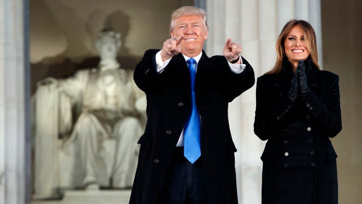 "President-elect Donald Trump, left, and his wife Melania Trump arrive to the ""Make America Great Again Welcome Concert"" at the Lincoln Memorial on Thursday."