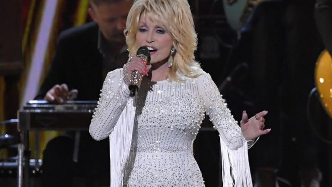 FILE - In this Nov. 13, 2019 file photo, Dolly Parton performs at the 53rd annual CMA Awards in Nashville, Tenn. Parton's $1 million gift to Nashville's Vanderbilt University helped researchers develop Moderna's experimental coronavirus vaccine, announced this week.