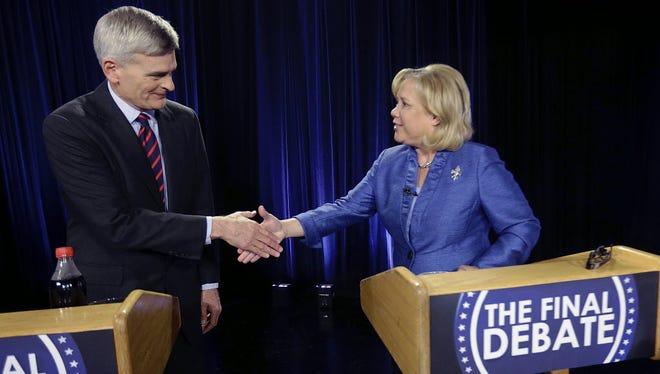 Republican Sen. Bill Cassidy, left, and Democratic Sen. Mary Landrieu meet before their final debate Dec. 1. Cassidy defeated Landrieu in a runoff election.