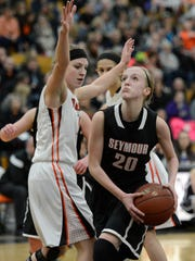 Seymour's Jenna Krause (20) drives to the basket during
