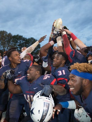 Northwest Community College players celebrate the State Championship Saturday at home, defeating Gulf Coast Community College 34-24.