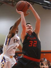 Stewarts Creek's Tyler Conley (32) goes up for a shot
