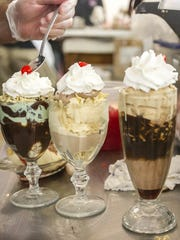 The finishing touches are placed on an ice cream sundae